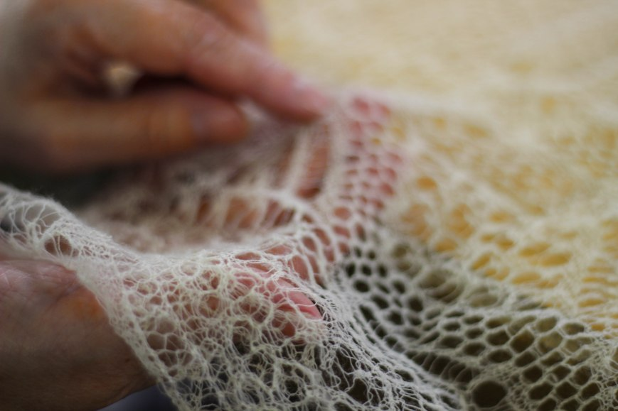 Sandra inspecting some lace